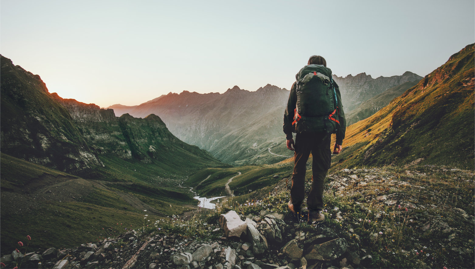 Man,Hiking,At,Sunset,Mountains,With,Heavy,Backpack,Travel,Lifestyle